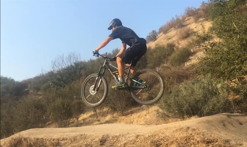 Picture of the teacher jumping a mountain bike at Vail Lake in Temecula, CA