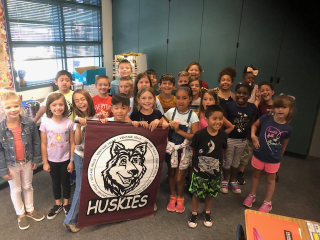 Mr. Paulsen's Class Holding the Husky Banner