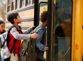 picture of students getting on to a bus