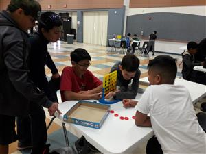 students playing connect 4 in qualifying round