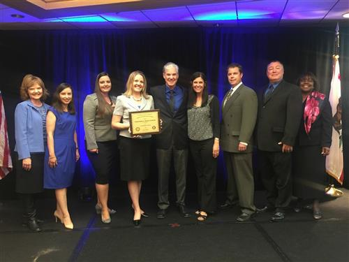 Nicole Dayus Receiving CHS Gold Ribbon Award with teachers, district staff including Superintendent Ritter, and Tom Torlakson